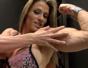 Female bodybuilder Maria G is posing for you in the bedroom in pink panties and high-heeled shoes, showing you her powerful pecs and the muscles of her vascular biceps and ripped abs. Tan fuerte, she says, stroking her muscular legs, glutes and calves. She's...