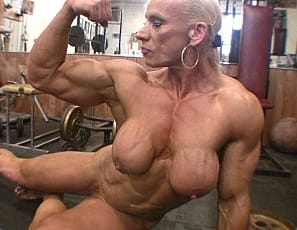 Muscular Nicole Savage realizes that she's not everyones cup of tea. Some prefer fitness girls to female muscle women with huge biceps, massive legs, and powerful vascular forearms. Nicole is a female bodybuilder, she works hard to get huge and she doesn't care...