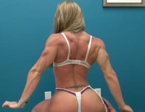 Tattooed professional female bodybuilder Maria G shows you how muscular and vascular her biceps, legs, pecs, glutes and calves are, and how ripped her abs are, as she poses for you in panties and high-heeled shoes. Muy caliente, she says, as she strokes her muscles....