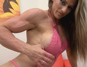 Professional female bodybuilder Maria G poses and flexes for you in high-heeled shoes, showing you her tattoo, her ripped and vascular pecs, legs, glutes, calves, biceps and abs! What more could you ask for?