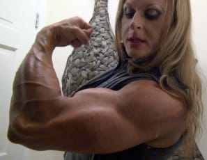 In your virtual session with female bodybuilder Nuriye, she poses to show you how ripped and vascular her biceps are, how powerful her pecs are, how massive her legs and calves are, and her muscle control. You are in my power, she tells you. And she means it....