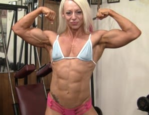 Female bodybuilder Nathalie Falk works her pecs and biceps muscles in the gym and poses to show you how ripped and vascular she is and how good her tattooed abs look. Feels good, she says with a smile.