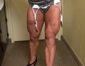Female bodybuilder Carla's posing for you in polka-dot panties, showing off the muscles of her ripped abs, vascular biceps, legs, and calves, powerful pecs and glutes, and her tattoo.