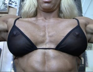 Like to watch? asks tattooed professional female bodybuilder Jill Jaxen as she works her vascular, muscular pecs and biceps muscles in the gym, posing in panties for you and showing you how ripped her abs and legs are.