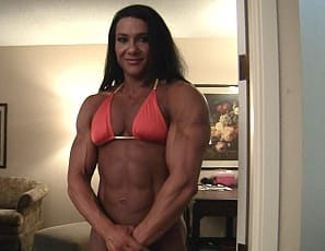Alina Popa is wearing the tiniest of bikinis - just enough to leave a little to the imagination. What isn't left to the imagination is pretty damned impressive. Big biceps, powerful quads and ripped abs. Alina also gives us her famous muscle control pec bounces...