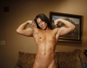 Jenna is totally nude in this photo set, and we can we say - she is a true work of art. From her perky pecs, to her ripped abs and vascular biceps and strong quads Jenna really has it all. Some people go to museums or art galleries to experience fine art. We think...