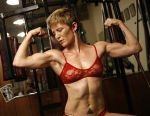VeVe is competitive powerful personality who loves Brazilian jiu jitsu and wearing red-hot lingerie in the gym. This redhead hits the gym with a passion. She poses, flexes and packs a powerful punch from her lithe frame.