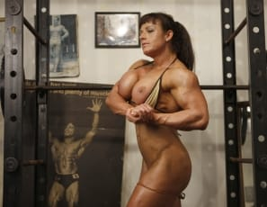Big Tinah is a big presence in the gym. From her bulging biceps, to her flat, ripped abs to her strong, muscular legs she's a force to be reckoned with. When Big Tinah hits the gym we suggest standing back and admiring her as she poses and flexes her muscles.