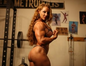 Female bodybuilder IronFire poses in the gym to show you her vascular,  tattooed muscles in nothing but tiny panties and high shoes. Her powerful pecs, big biceps, ripped abs, strong legs, gorgeous glutes and curvaceous calves look so hot, you'll think she's on...