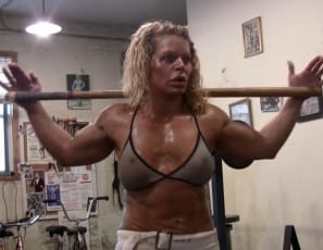 she shows you her big, vascular biceps, her ripped abs