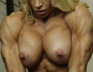 You'll want to take a long, hard look at professional female bodybuilder Jill Jaxen posing topless in panties in the gym. Every muscular inch of her is ripped and vascular, from her pecs, biceps and abs to her legs, glutes and calves to her tattooed back.