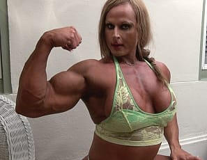 Female bodybuilder Nuriye poses for you in panties in your virtual session, humiliating you verbally as she shows you how vascular and ripped the muscles of her pecs, legs, biceps, and abs are and tells you what she's going to do to you.