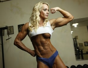 Professional female bodybuilder Carmen is so ripped and vascular, it's like she was carved by a muscle sculptor. Look at her biceps, pecs,  abs, glutes,  legs and  calves as she poses in the gym. She's a living work of art.