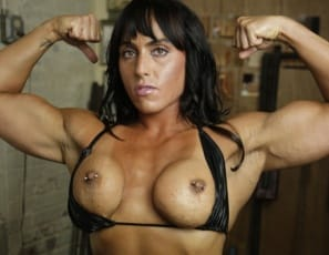 Beautiful work of art. That's what female bodybuilder Whitney looks like when she's posing nude in the gym. Look at her powerful pecs, vascular biceps, muscular glutes, legs, and calves, the tattoos on her abs, and her sweet kitty, and you'll want to a take a Monet...