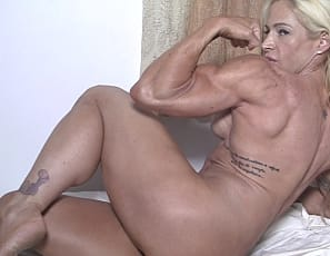 Professional female bodybuilder Jill Jaxen is posing for you in the bedroom, showing off her muscular pecs, legs, glutes and abs, her big, vascular biceps, and her tattoos. Would you even know what to do with me if you found me in your bed? she asks. Well, would...