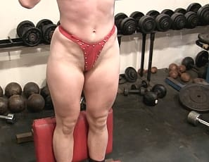 Orlandoe and VeVe do a girl/girl fitness contest in the gym in panties, bodybuilding their legs, glutes, and tattooed abs while you watch their female muscles close up.