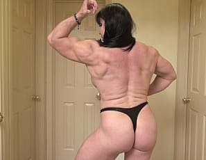 Female bodybuilder Ripped Princess is posing for you, showing off her ripped abs, powerful pecs, big biceps, close-up, muscular legs and glutes, and her muscle control. Those massive muscles make her the Princess of Power.