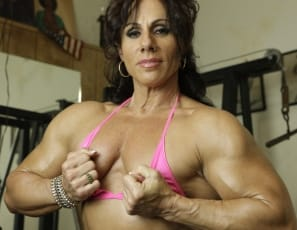 Professional female bodybuilder Annie Rivieccio works her vascular pecs  and biceps barefoot  in the gym, taking off her shoes  and panties and posing nude to show you how ripped her muscular abs, legs and glutes are. That feels so good, she says. Wouldn't you...