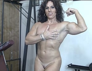Professional female bodybuilder Annie Rivieccio works the muscles of her pecs, vascular biceps, ripped abs and big legs in the gym, and poses nude to show you the results. Get a close-up look at her pretty kitty.
