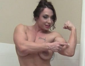 Female bodybuilder BrandiMae's posing for you as she gets ready for a bath, taking off her bikini, showing off her 15 biceps, powerful tattooed pecs, taut abs and muscular legs and glutes, and giving you a look at her pretty pussy.