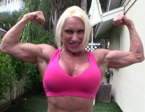 Ripped female bodybuilder Ashlee Chambers turns coach, trying to get a couple in shape. She's so strong she can lift and carry both of them, so she decides to use them as weights to strengthen the already massive, vascular muscles of her pecs, biceps, abs, legs,...