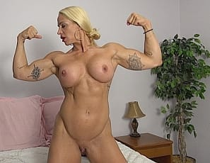 Female bodybuilder Jill Jaxen wants to know if you've ever watched anyone pose for you in bed. Nude in high-heeled shoes, that's what she does, giving you a close-up look at her sexy pecs, ripped abs, vascular biceps, muscular legs and glutes, and her tattoo.