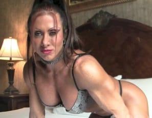 female bodybuilder Monica Martin is posing in the bedroom