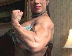 female bodybuilder Monica Martin is posing in the bedroom