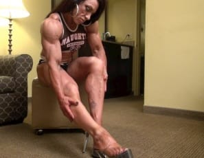 Wearing sky-high heels and a Naughty University top in the bedroom , tattooed female bodybuilder Carla poses to show you how vascular her big biceps are, how ripped her abs are, and how much control she has over the muscles of her pecs, legs, glutes and calves....