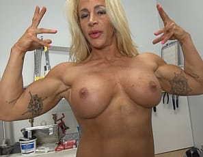 Professional female bodybuilder Jill Jaxen is posing nude with power tools, showing you how powerful the muscles of her vascular biceps and pecs, her ripped, tattooed abs, and her muscular glutes and legs are. Watch her muscle control and answer her question: Do...