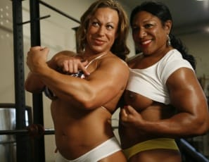 Female bodybuilders, Carmella Cureton and MuscleFoxx are training in the gym, and with that much sexy ebony female muscle on display, it's not surprising that girl/girl muscle worship starts happening as they fondle each other's pecs, legs, glutes and biceps...
