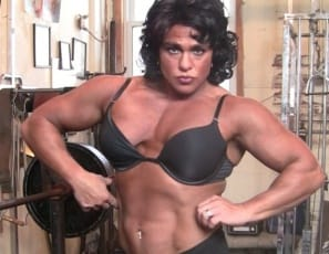 Female Bodybuilder Dana works her pecs, traps and biceps in the gym, then poses nude to show you the results with mature female muscle. You'll like the look of her strong legs, glutes and abs too.