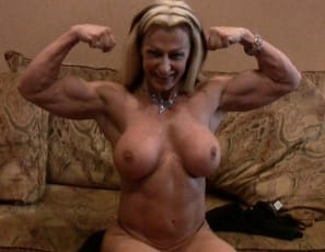Mature female bodybuilder Gina Jones is posing for you in the bedroom, showing you how ripped and vascular she is, and pointing out all her hard muscles: her wide lats, her big pecs and biceps, her strong legs and glutes and her awesome abs. Now that you've met...
