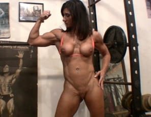 Hot Italian is looking hot, ripped and vascular as she bodybuilds, doing squats in the gym, working the muscles of her pecs, legs, biceps and abs, and posing to show off the results.  It's hot in here, she says, and it gets even hotter when she takes off her...