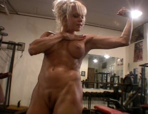 Mature female bodybuilder Mandy K works her hard biceps muscles in the gym, then gets naked and poses to show you her strong legs and glutes, her powerful pecs, her tight abs and her tattoos.