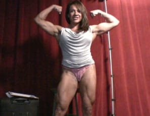 Rica's on stage telling you she can bench and squat 225, and curl 40, but what really turns this female bodybuilder on is that she can be stronger than a man. She loves posing and showing off her muscular pecs, legs, abs and 15-inch biceps. Posing gets me wet,...