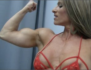 Female bodybuilder Maria G is posing and slowly stripping off her tight blue dress, showing you her gorgeous glutes, luscious legs, muscular calves, in high-heel shoes, big biceps and tight abs – and her back tattoo as she plays with her peekaboo bra and panties....