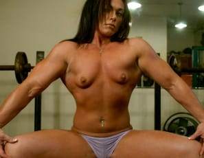 Posing and working out half-naked in the gym, Kim Birtch shows off her sexy pecs, muscular legs, beautiful biceps, gorgeous glutes and her teasing tattoo. But her sweet smile shows you that she has nothing to Birtch about.