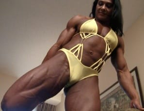 Professional female bodybuilder Alina Popa is stretching the massive muscles of her pecs, legs,  glutes,  calves,  biceps,  and abs and posing to show you how vascular and ripped she is and how good her muscle control is. Now that's a body.