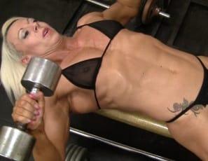 Professional female bodybuilder Nathalie Falk is posing in thong panties