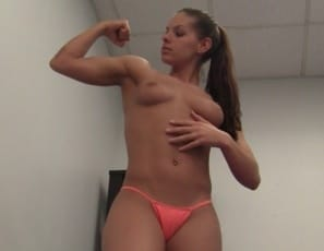 Skylar's preparing for a girlfight. She's posing, flexing her biceps and pecs and stretching her flexible, muscular legs, glutes and abs, naked except for tiny panties. I'm ready for a knockout, she says. You're already seeing one.
