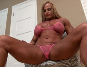 Female bodybuilder Nuriye is a true-life amazon. In your virtual session, she's posing in high-heeled shoes and fishnet panties and showing you how vascular and muscular her biceps, legs, and calves are, how ripped her abs are and her muscle control of her pecs....