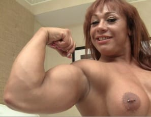 Come closer and kiss my bicep, professional female bodybuilder Rita whispers as she poses nude for you in the bedroom, showing off her tattooed, muscular, vascular legs, glutes, and abs and her powerful pecs, and giving you a look at her pierced kitty. You cannot...