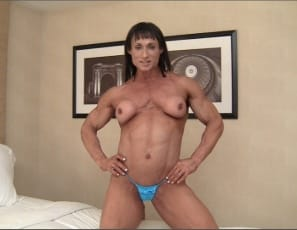Professional female bodybuilder Tazzie Colomb poses for you in the bedroom from the Arnold Classic. You get to see the vascular, ripped muscles of her legs, glutes, calves, biceps and abs – and you also get to see her naked pecs, which Arnold missed out on when...