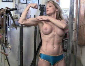"In the gym, Mandy K explains that her powerful muscles are ""so strong I could squash you."" Watch her work out her strong legs and glutes, her big biceps and her tight abs as she does dips, then look at her pose to show you her massive calves, and you'll agree...."