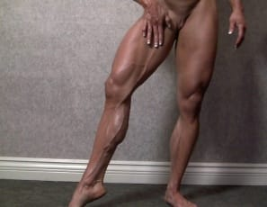 "Barefoot in the bedroom, bodybuilder Angela Salvagno poses naked for you and taunts you, saying ""Feel how hard I am"" as she touches her muscled pecs, her huge, vascular biceps, and her massive legs, glutes and calves. ""You want to touch it, don't you?""..."