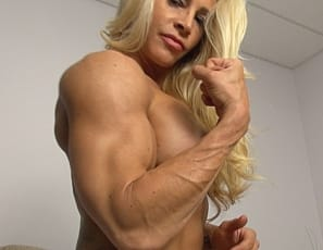 In a virtual session in her bedroom, female bodybuilder Jill Jaxen demonstrates her Muscle Control by doing some Pec bounces for you, poses nude in high-heeled shoes, showing off her ripped abs, vascular biceps, strong glutes and legs, and her tattoos, then gives you a close-up look at her pretty kitty and asks,