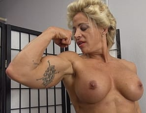 Tattooed female bodybuilder Jill Jaxen asks you