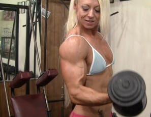 Female bodybuilder Nathalie Falk works her pecs and biceps muscles in the gym and poses to show you how ripped and vascular she is and how good her tattooed abs look.