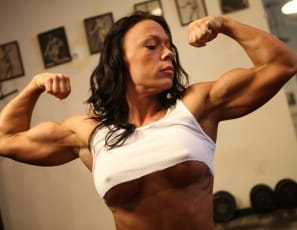 Bella's a female bodybuilder, and what a ripped, vascular body she has